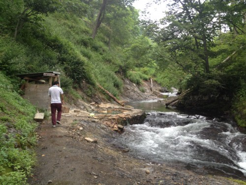 The back of the campsite, there is a beautiful river and free hot spring.